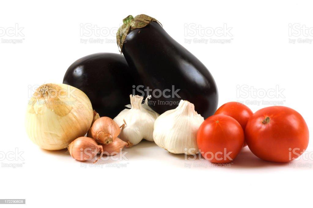 Fresh Whole Vegetable Arrangement Eggplant,tomatoes,onion,garlic,shallots royalty-free stock photo