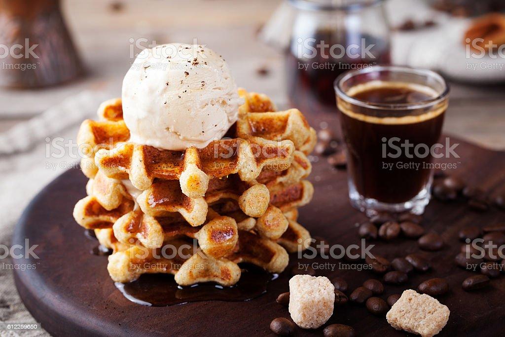 Fresh whole wheat waffles, ice cream, maple syrup stock photo