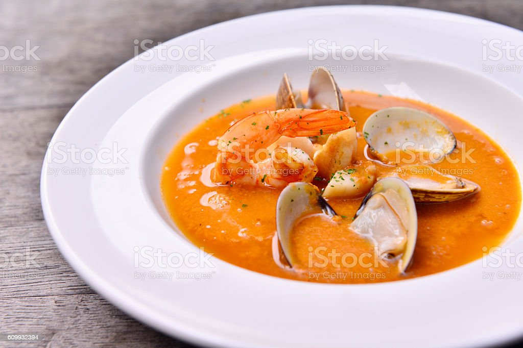 Fresh wild mushroom soup with clams and shrimps on white stock photo