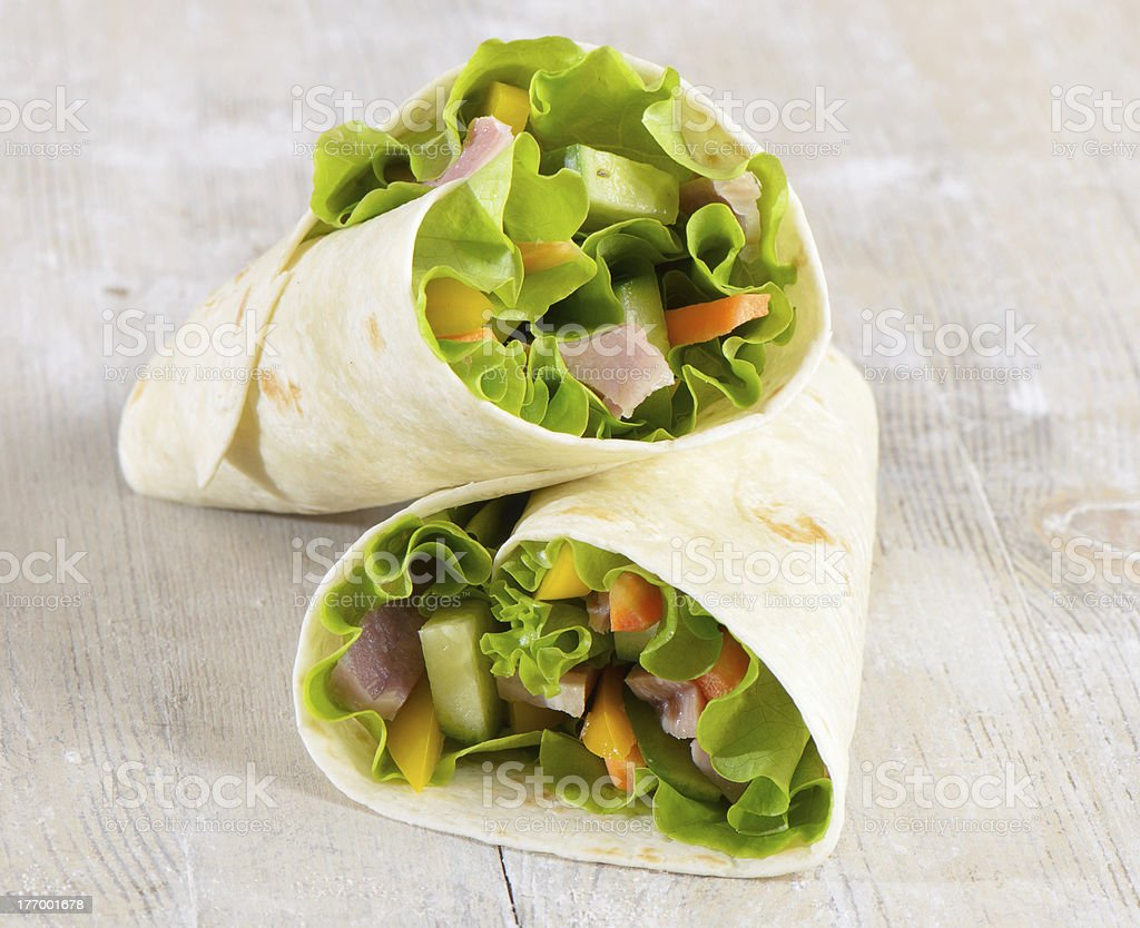Fresh wrap sandwiches filled with ham, lettuce and pepper royalty-free stock photo