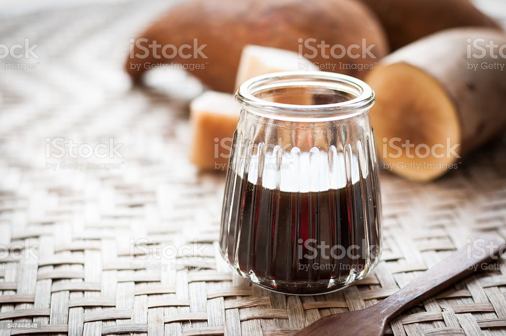 Fresh Yacon roots with yacon syrup on wooden board stock photo