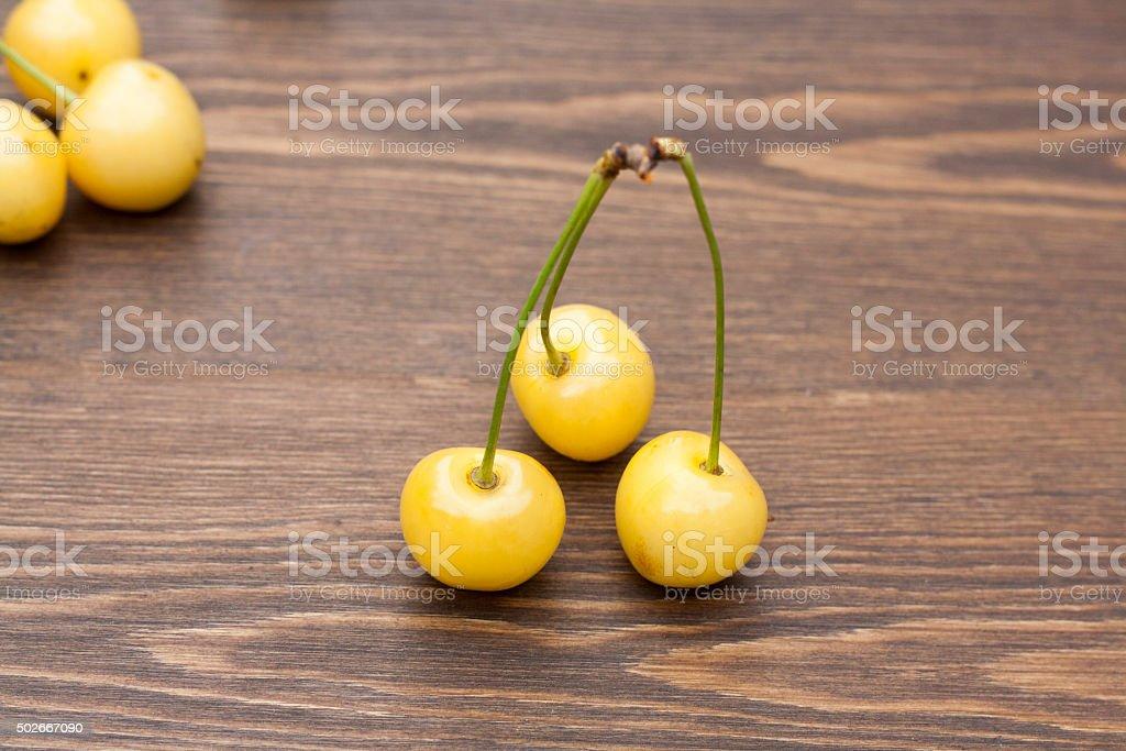 Fresh yellow cherry stock photo