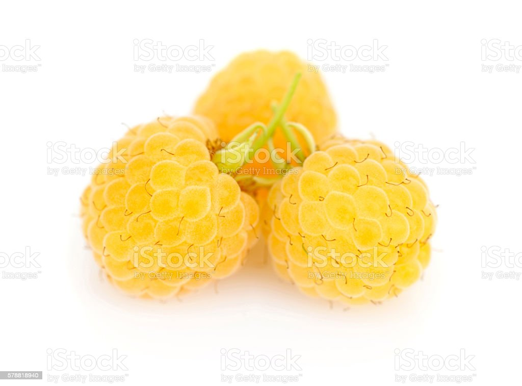 Fresh yellow raspberries on white background stock photo