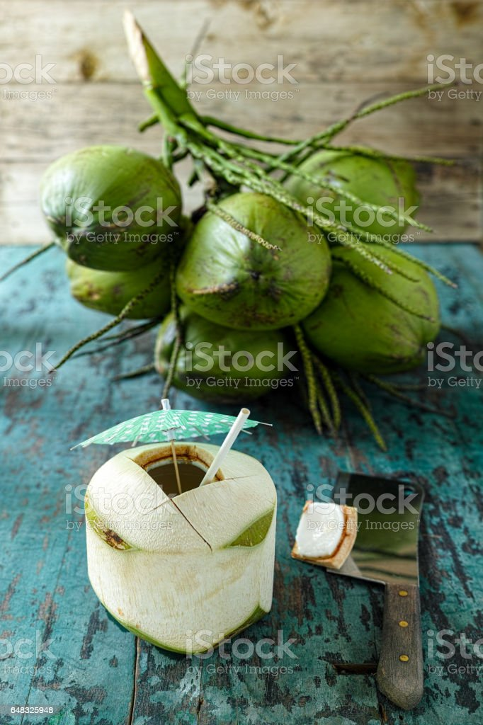 Fresh young coconut full of the super natural healthy drink, coconut water. stock photo