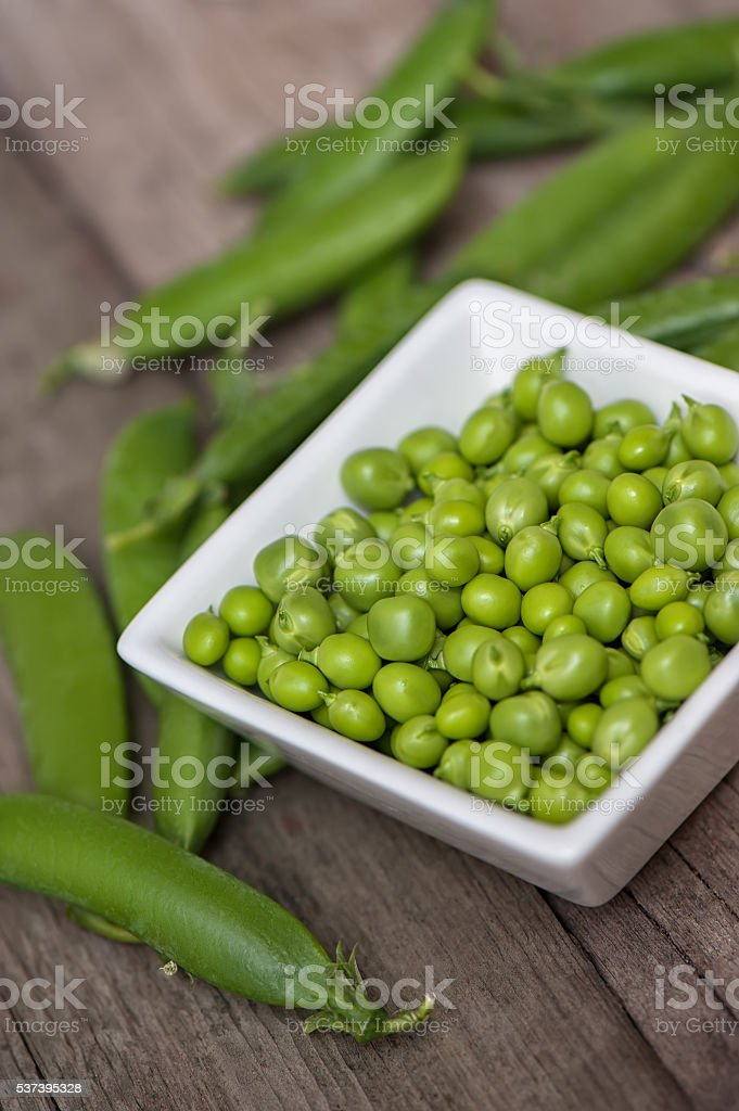 Fresh, young green peas. stock photo