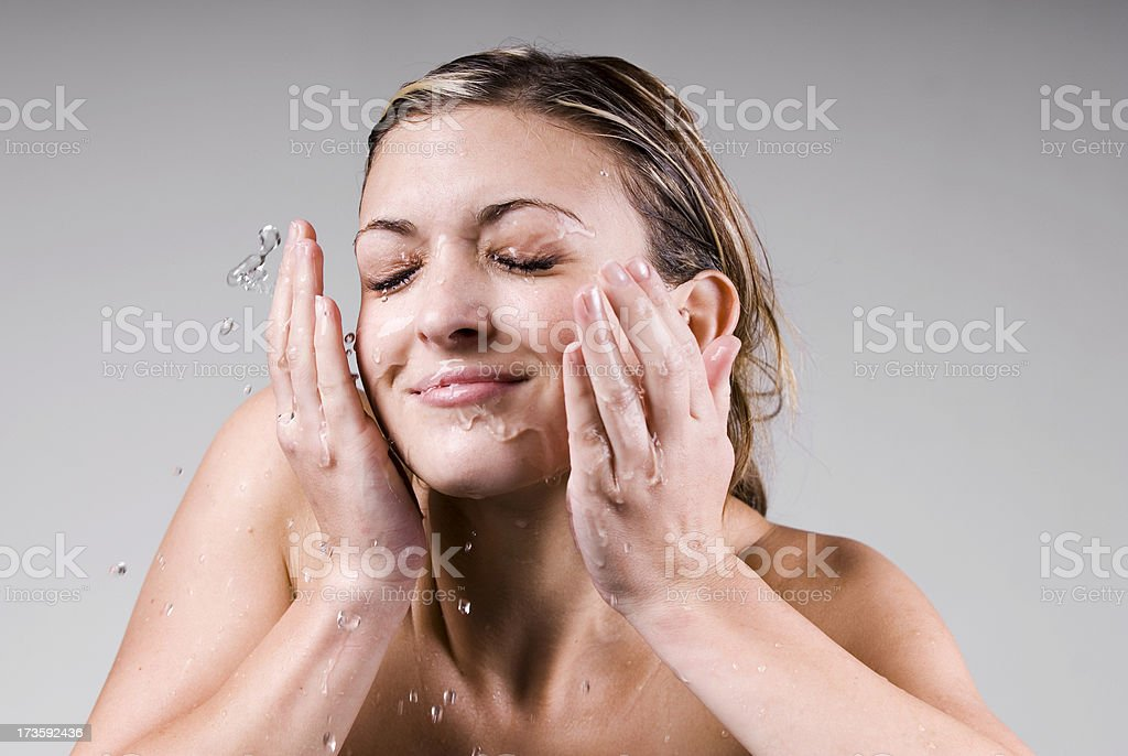 Fresh Young Woman Splashes Water on Face royalty-free stock photo