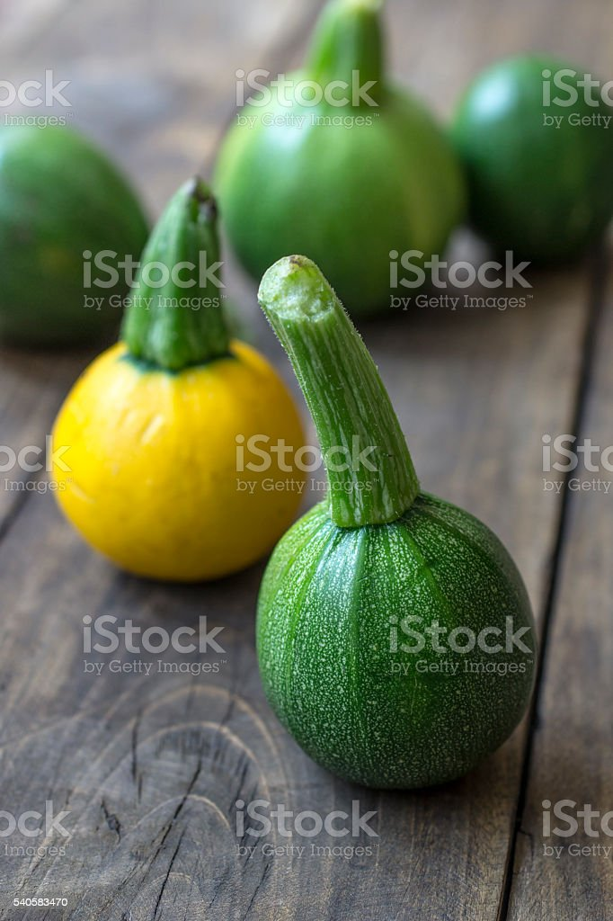 Fresh zucchini  on wooden table stock photo