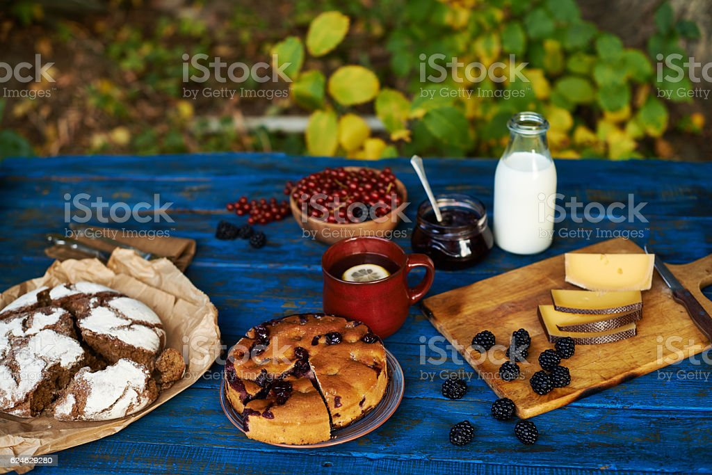 Fresh-baked sweet bread, ripe berries, sliced cheese stock photo