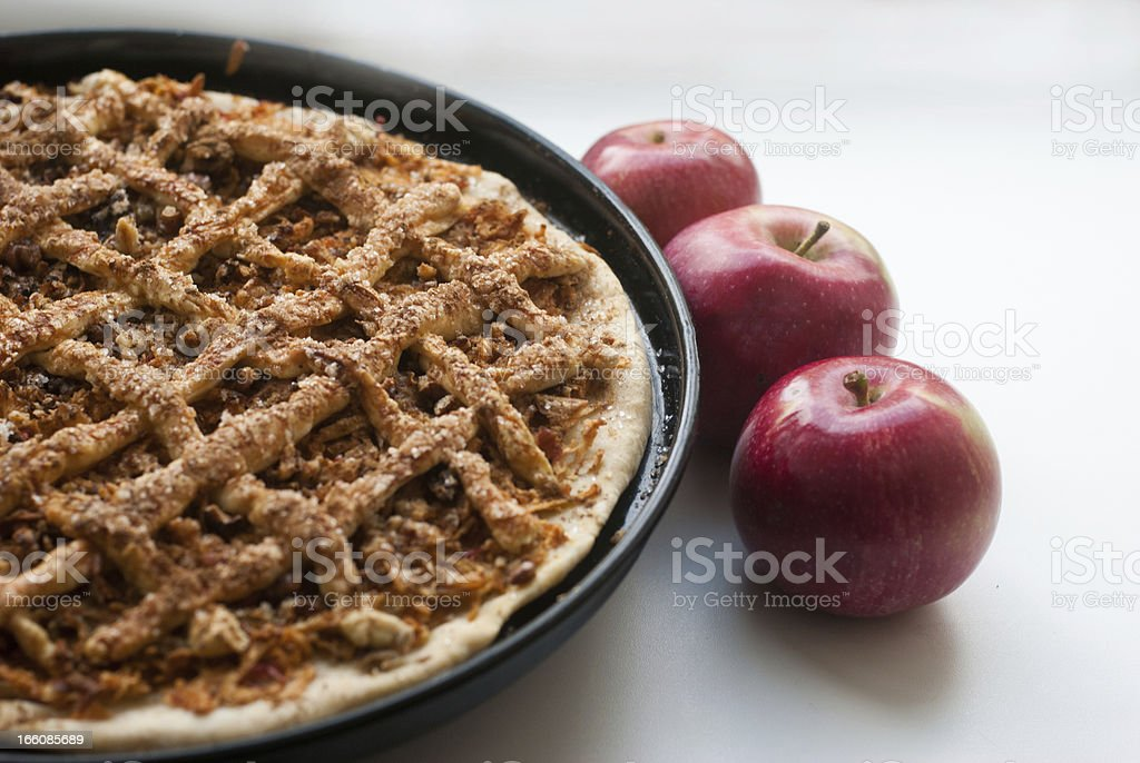 Freshly baked apple pie with apples royalty-free stock photo