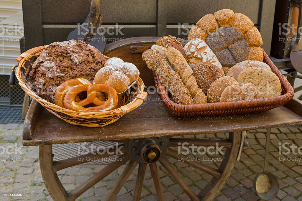 Freshly baked bread in front of portable wood fired oven stock photo