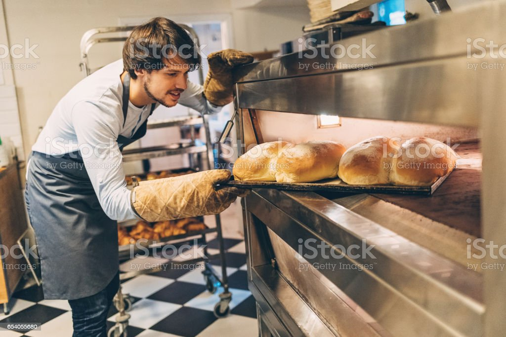 Freshly baked bread ready for display in the bakery stock photo