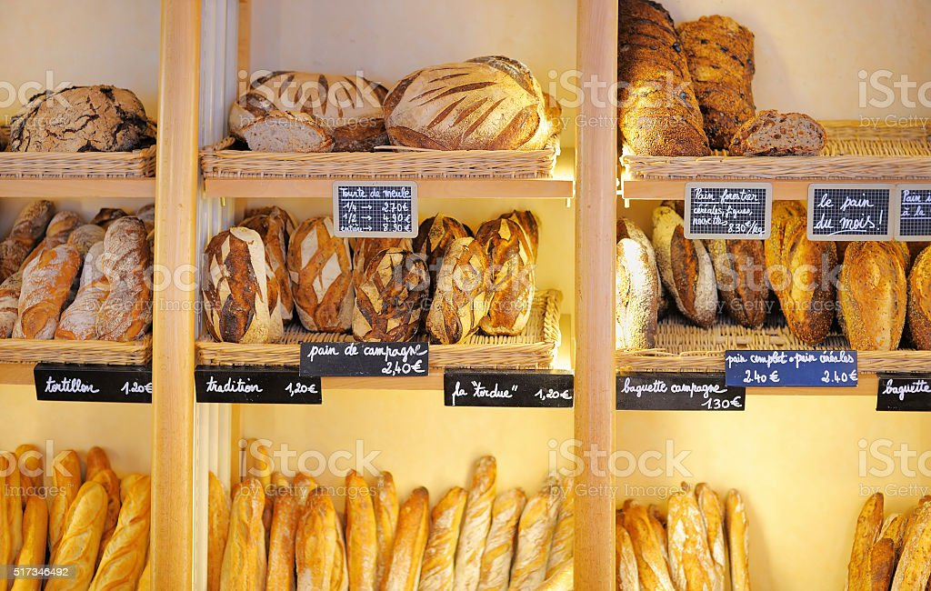 Freshly baked breads in French bakery stock photo