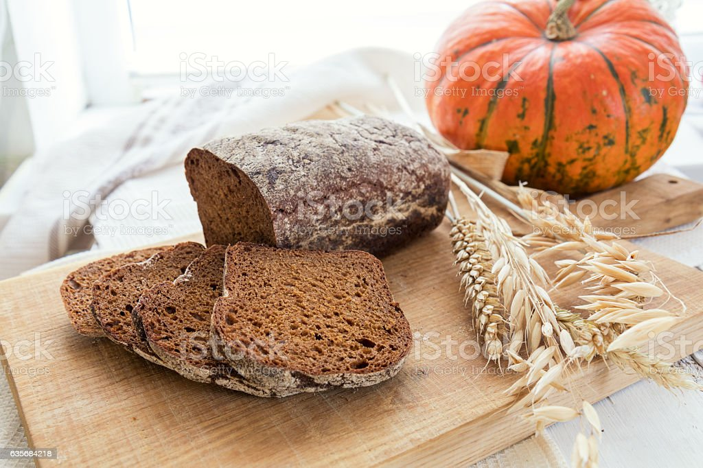 Freshly baked breads with ears and pumpkin stock photo