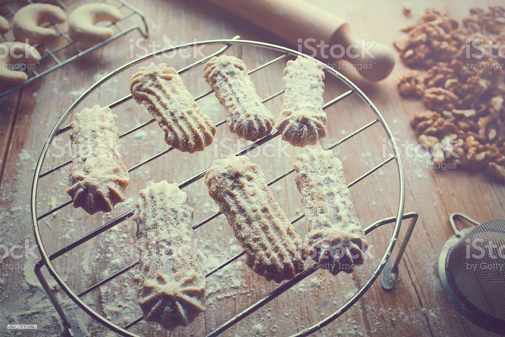 Freshly baked Christmas cookies on a metal tray stock photo