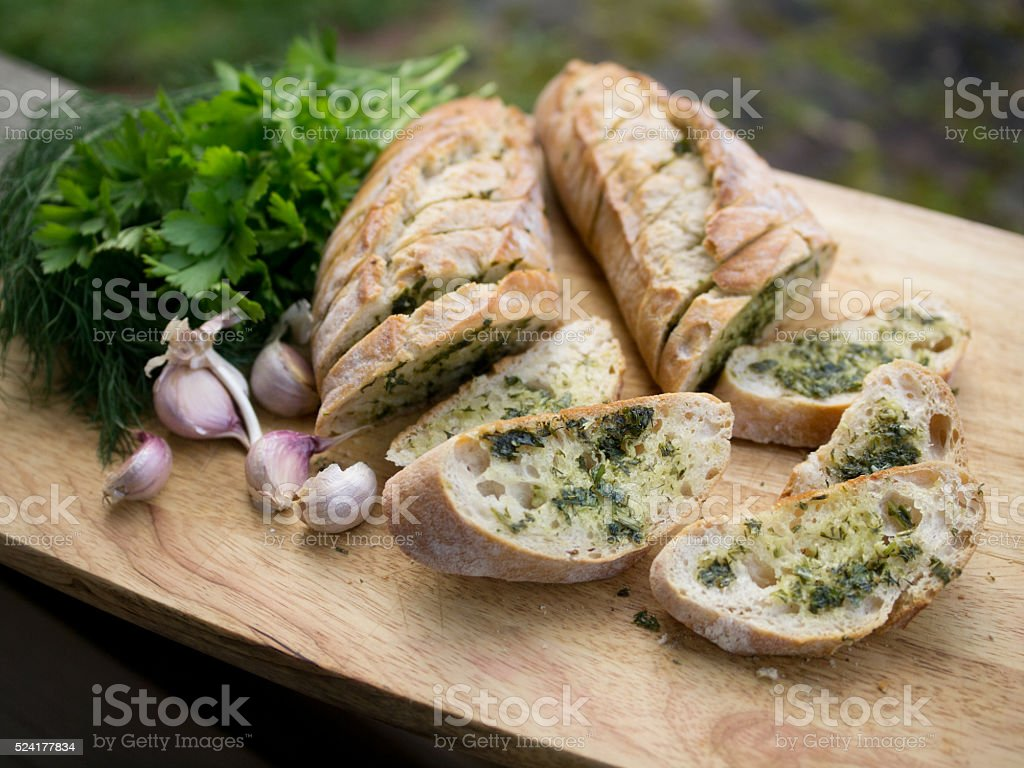 Freshly baked garlic bread with herbs royalty-free stock photo