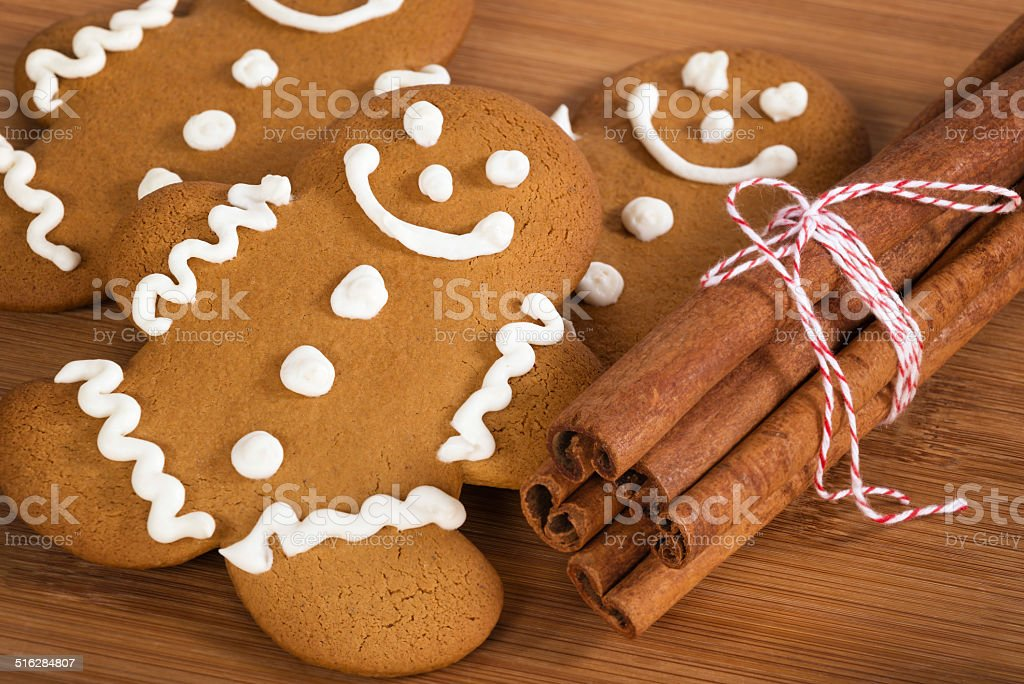 Freshly baked gingerbread man cookies and cinnamon sticks stock photo