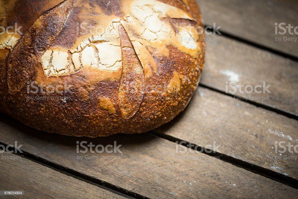 freshly baked homemade rye bread on wooden background stock photo