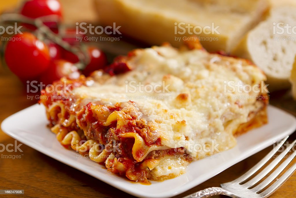 Freshly baked lasagna with lots of cheese stock photo