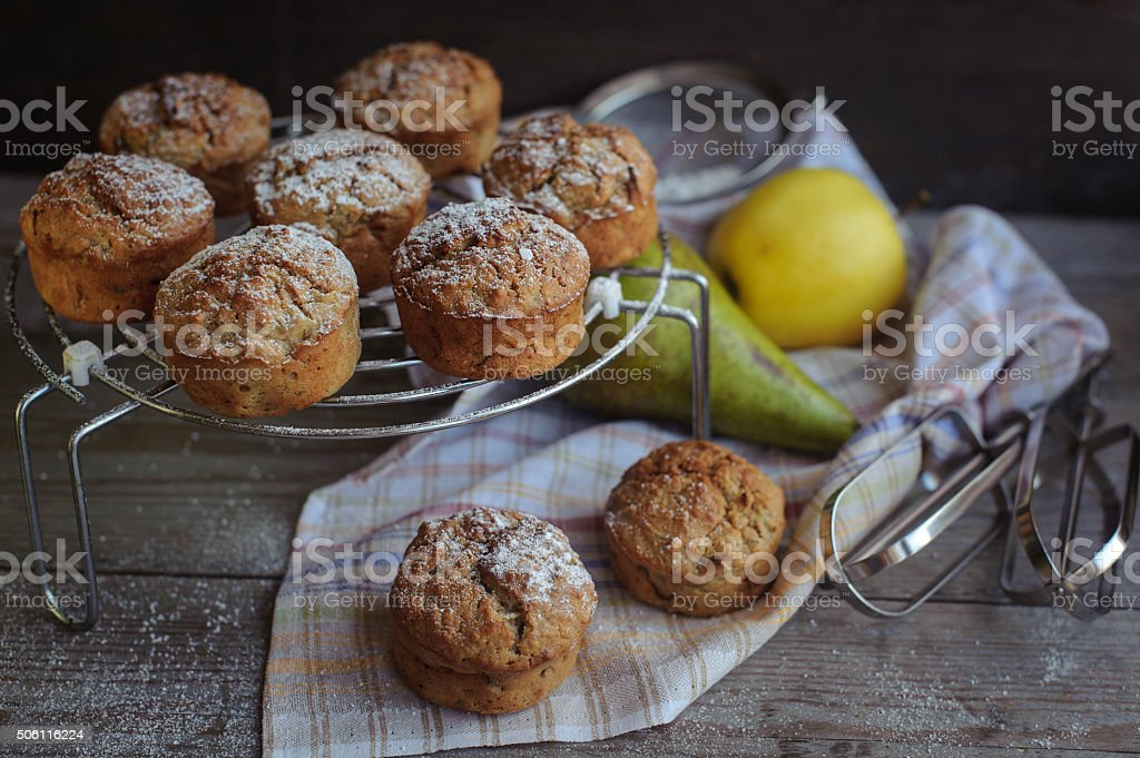 Freshly baked muffins with pear and apple stock photo