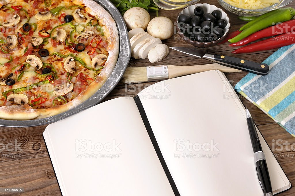 Freshly baked Pizza with cookbook royalty-free stock photo
