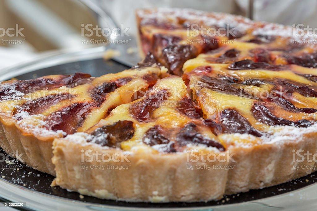 Freshly baked plum pie in organic bakery stock photo