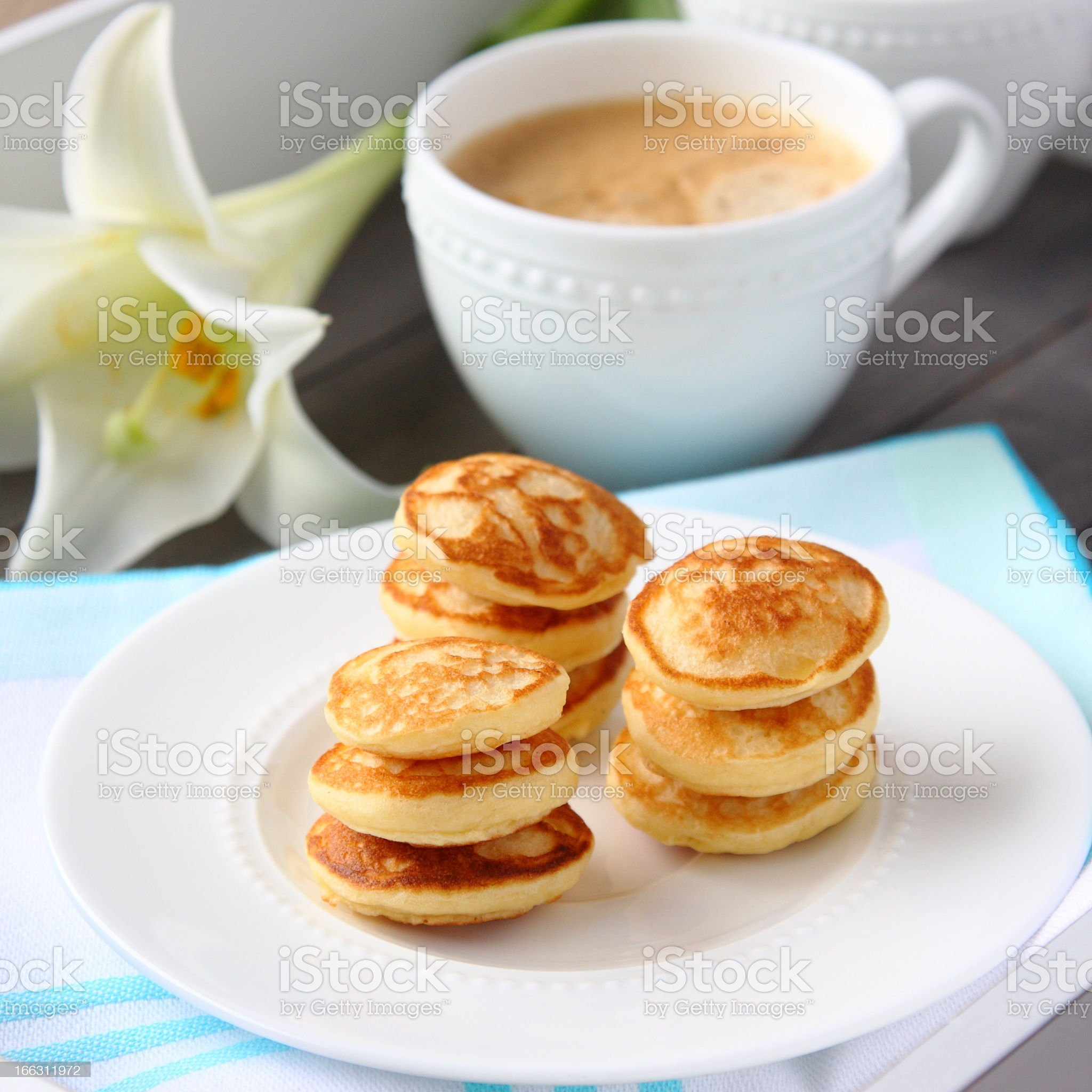 Freshly baked poffertjes - traditional Dutch little pancakes royalty-free stock photo