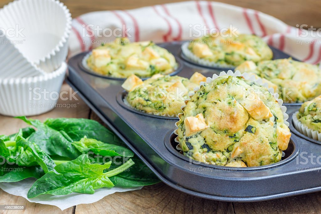 Freshly baked snack muffins with spinach and feta cheese stock photo