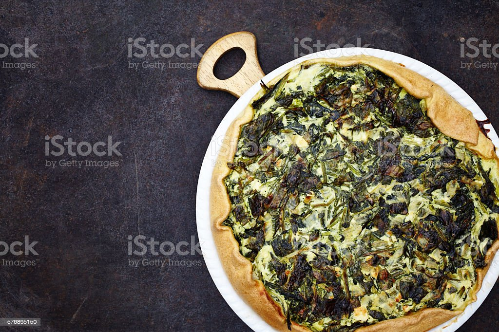 Freshly baked spinach quiche stock photo