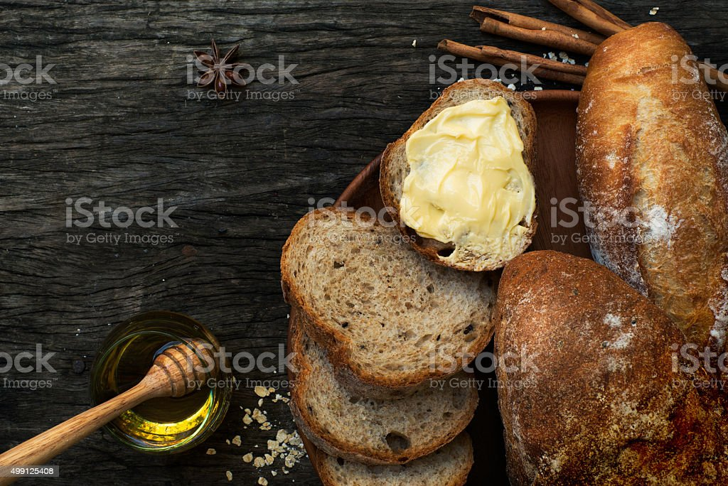 Freshly baked traditional bread on a wooden table stock photo