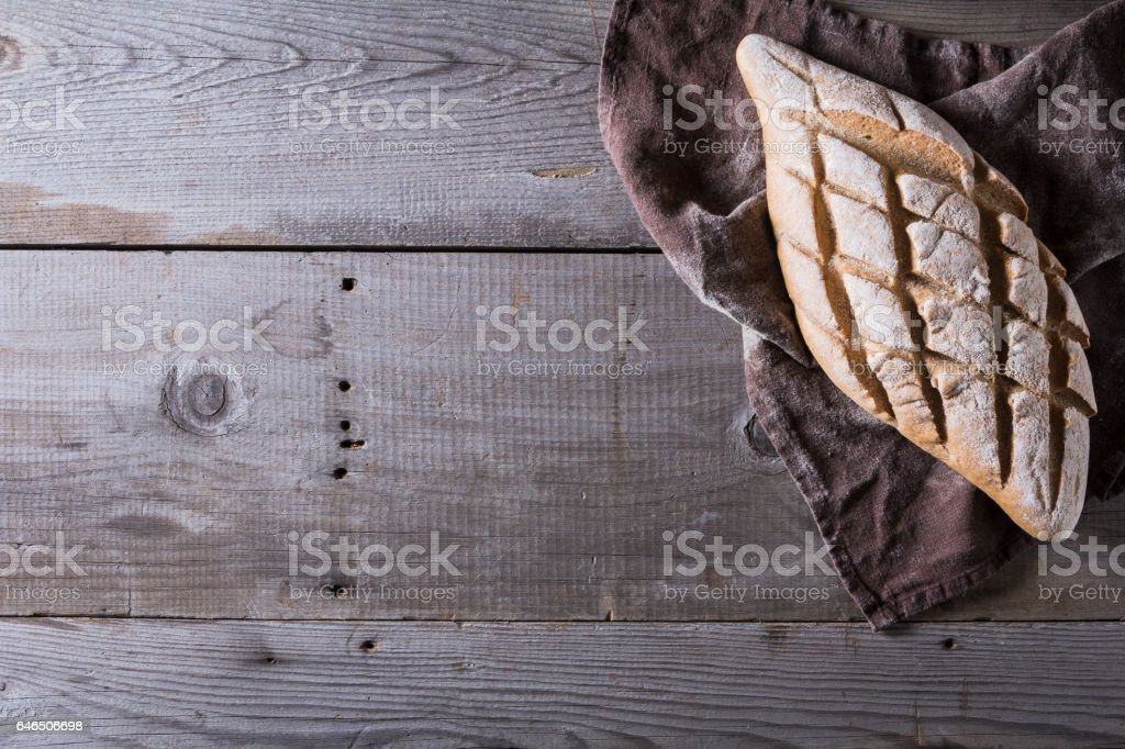 Freshly baked traditional bread on wooden table stock photo