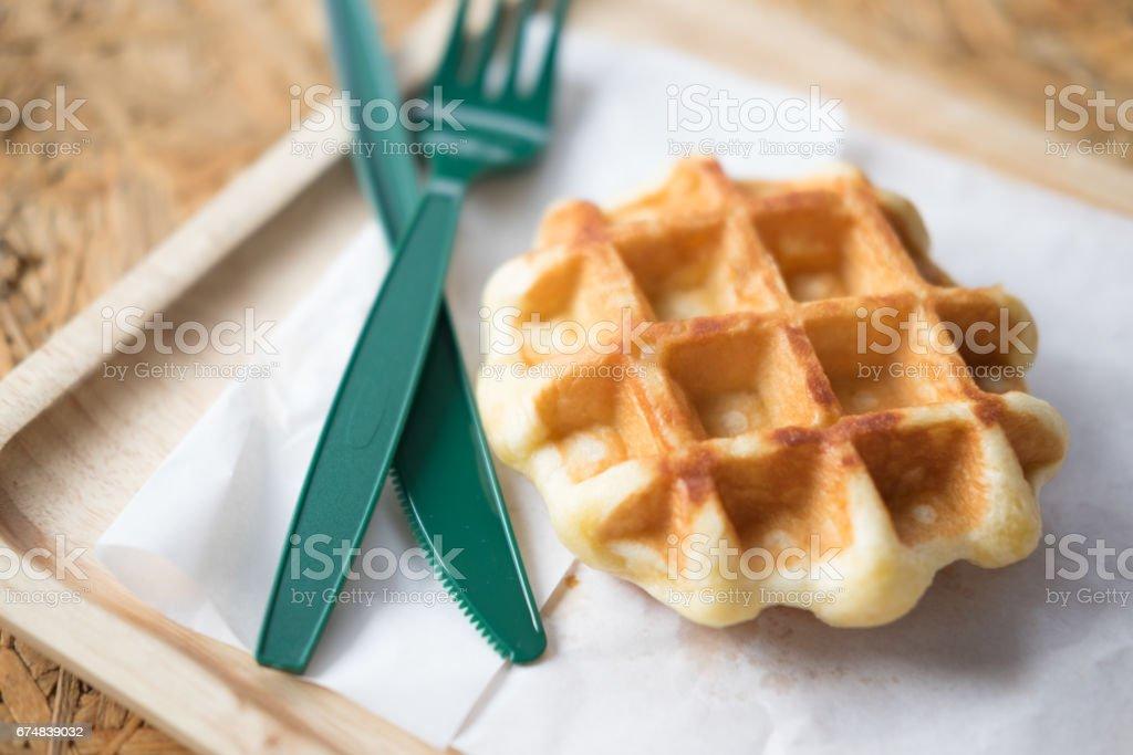 Freshly baked waffle on a wood background stock photo