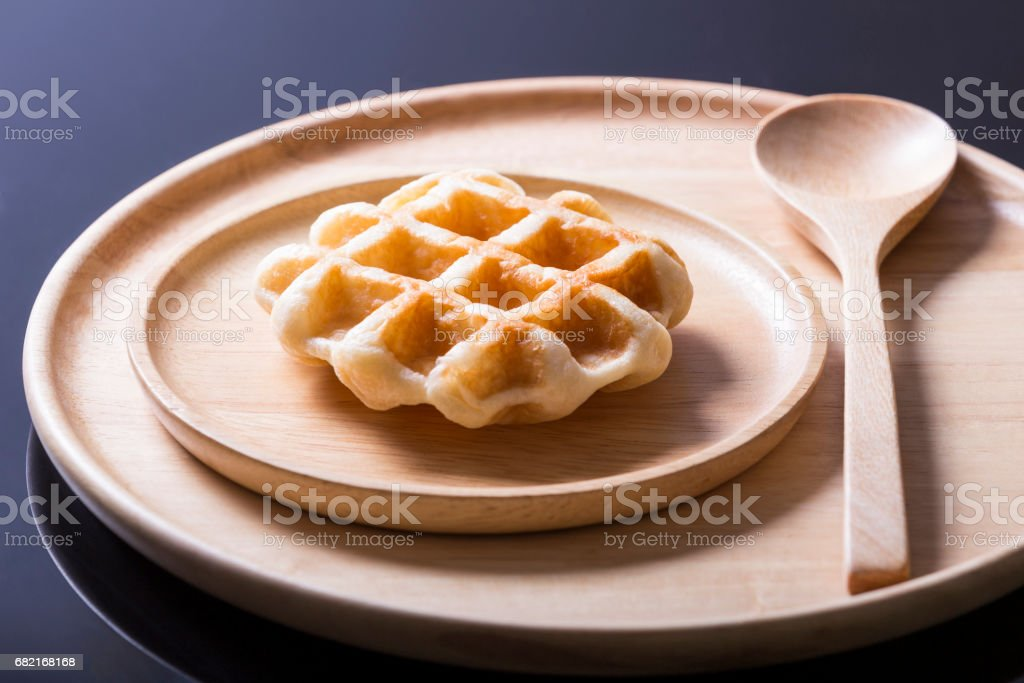 Freshly baked waffles on wood plate stock photo