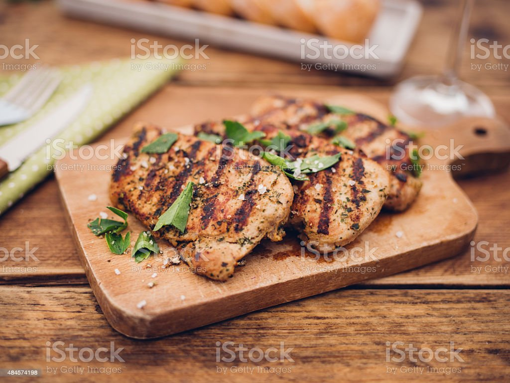 Freshly barbecue grilled pork fillets with herb seasoning stock photo