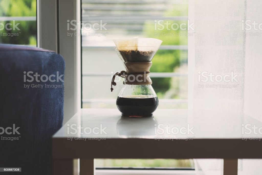Freshly brewed coffee in glass coffee pot stock photo