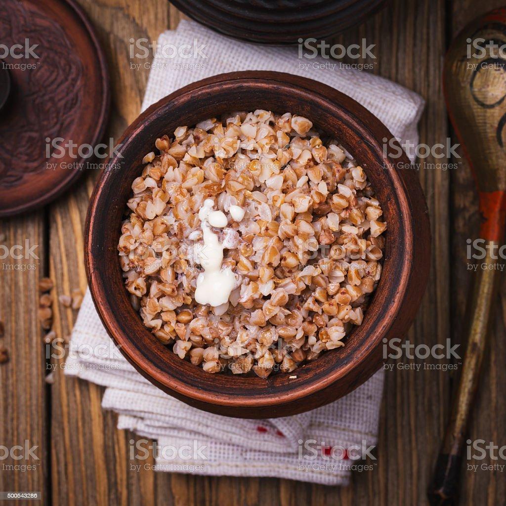 Freshly cooked buckwheat porridge in a clay pot, top view stock photo
