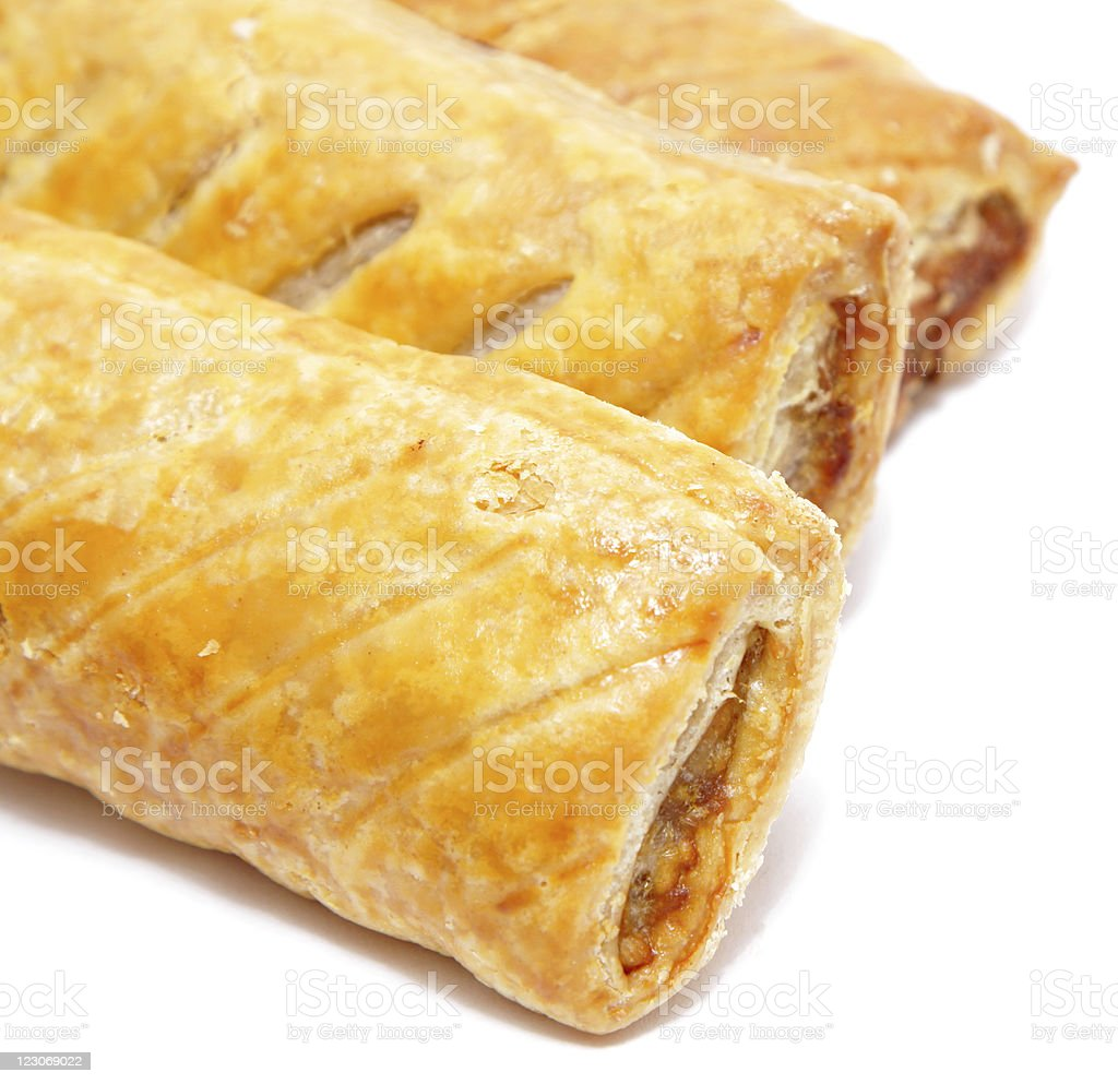 freshly cooked sausage rolls stock photo