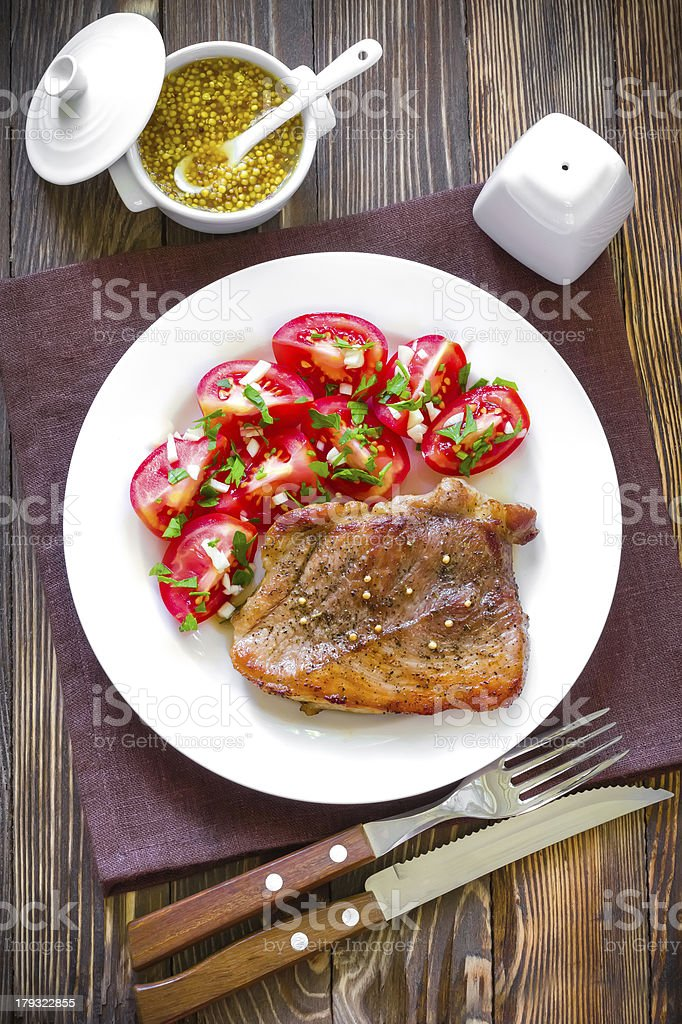 Freshly cooked steak with tomato salad and mustard royalty-free stock photo