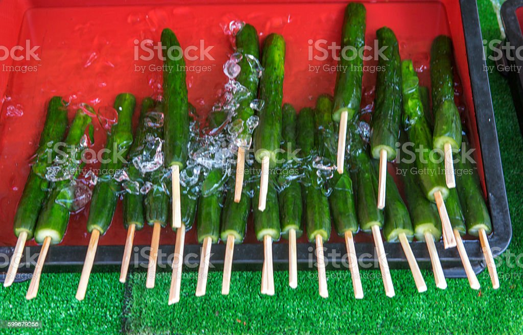 freshly cut cucumbers as snack in icy-water at kyoto japan stock photo