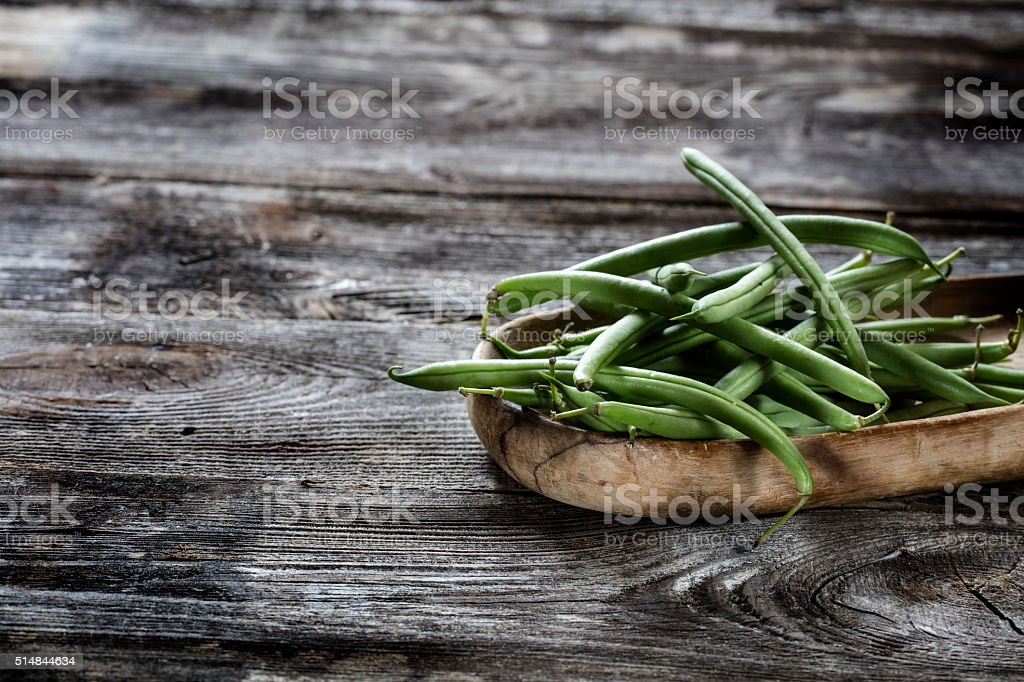 freshly cut green beans set for vegetarian home-made cuisine stock photo