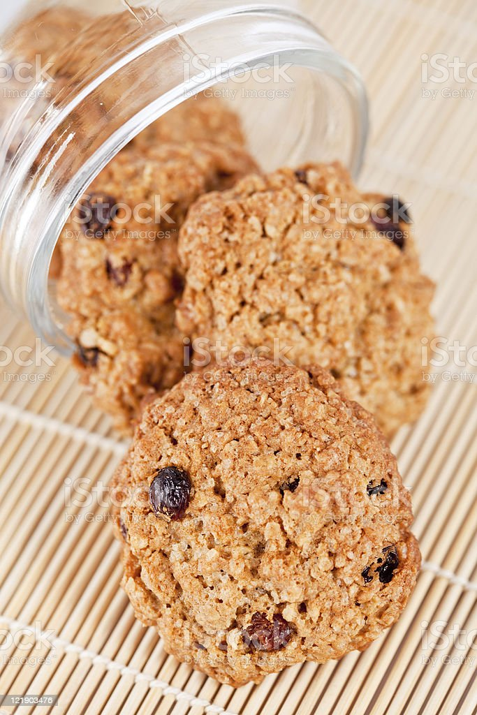 Freshly delicious baked oatmeal raisin cookies in a glass royalty-free stock photo