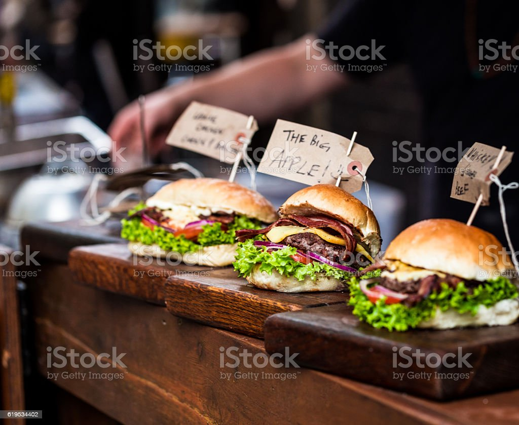 Freshly Flame Grilled Burgers at Borough Market, London, UK stock photo