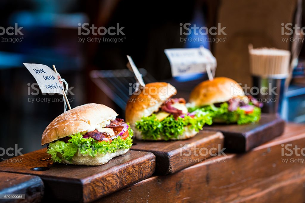 Freshly Flame Grilled Burgers at Borough Market, London, UK stock photo