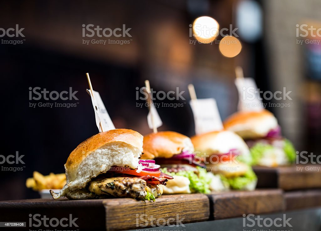 Freshly Flame Grilled Burgers on Wooden Boards stock photo