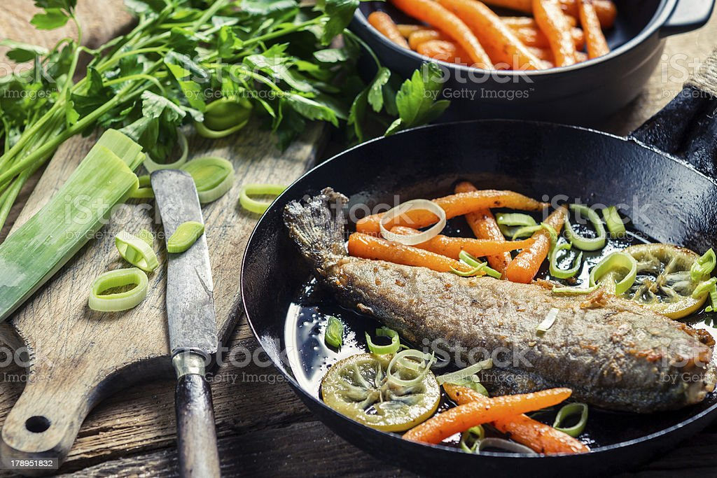 Freshly fried fish with lemon and parsley royalty-free stock photo