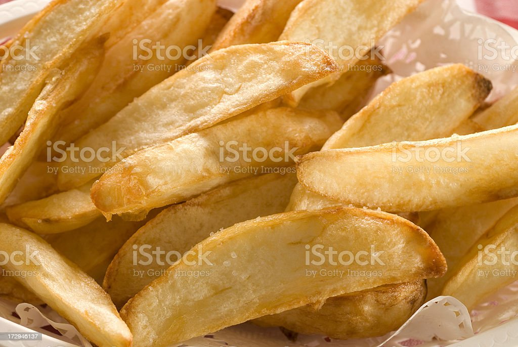 Freshly fried hand cut French fries royalty-free stock photo