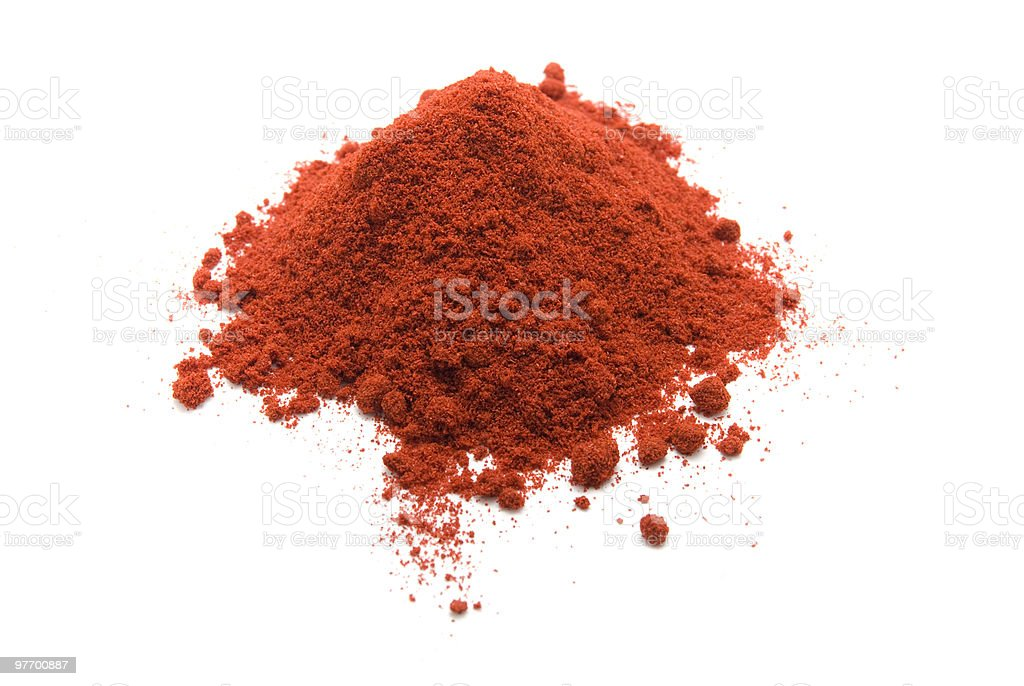 Freshly ground pile of orange paprika powder stock photo