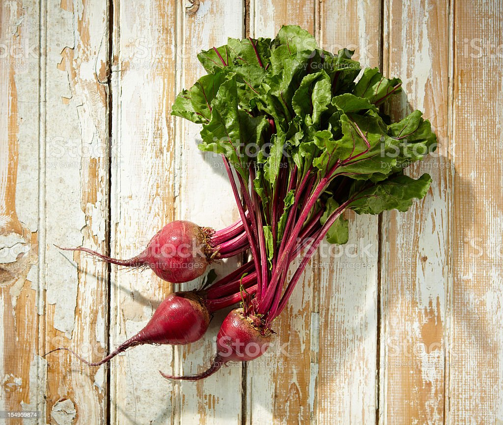 Freshly harvested beets on wood stock photo