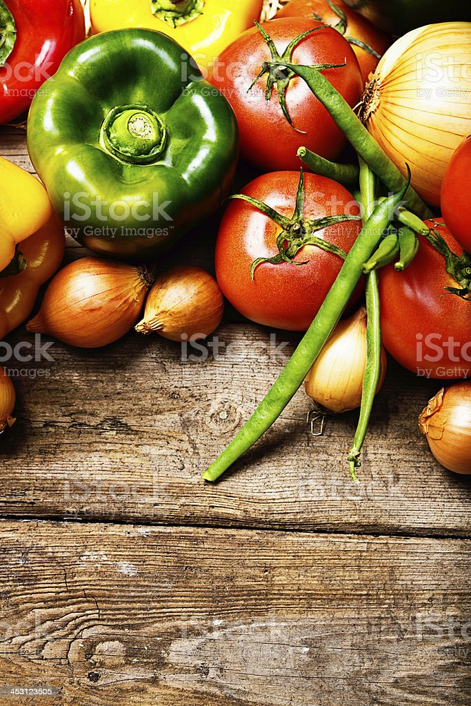 Freshly harvested produce on rustic wooden board at market royalty-free stock photo