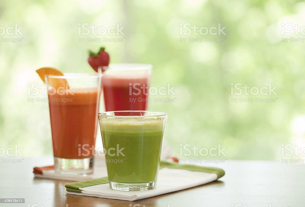 Freshly juiced organic vegetable and fruit juice royalty-free stock photo