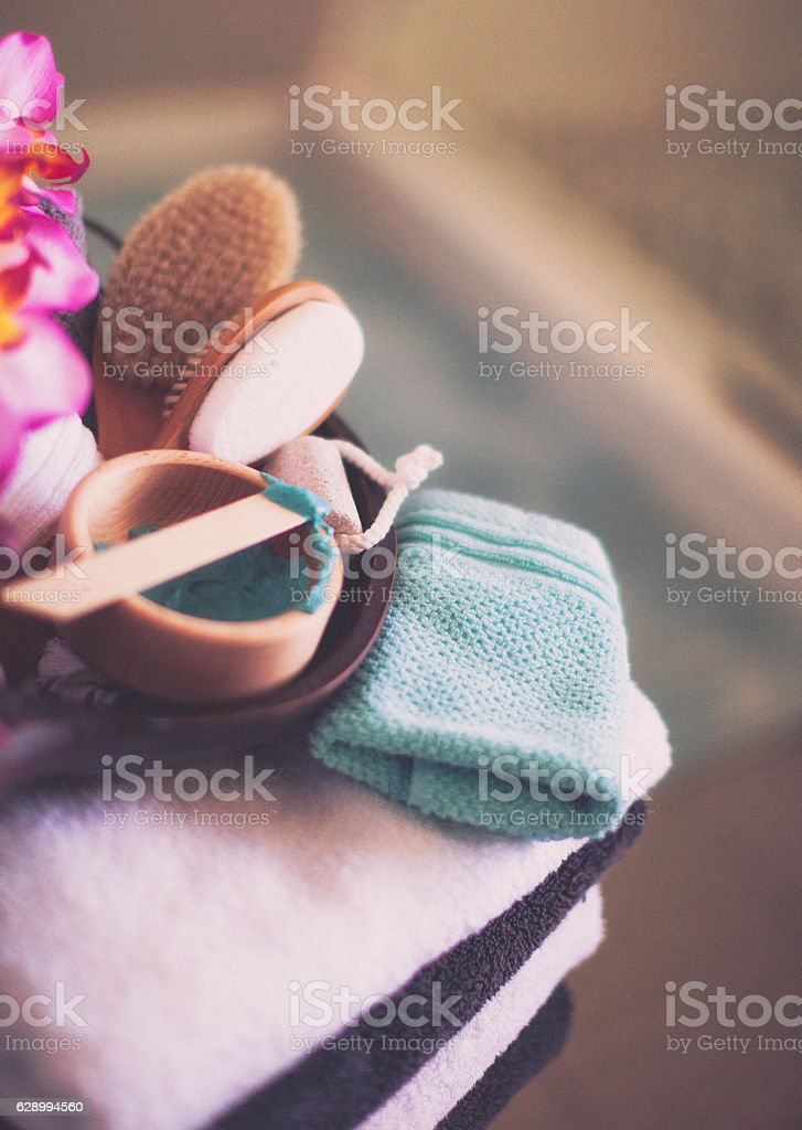 Freshly laundered towels, body scrub and spa body care essentials stock photo